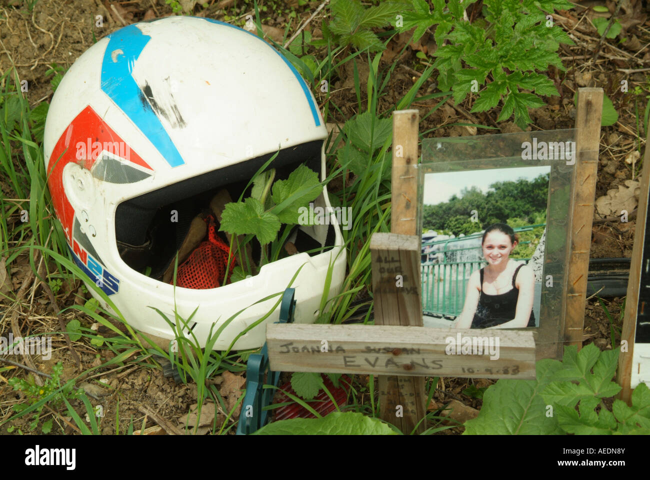 A road-side memorial to a young girl killed in an accident involving a motor bike. - Stock Image