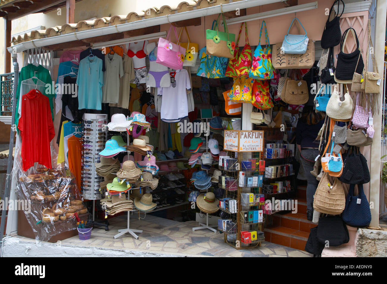 Tourist shop display of hats bags and tee shirts in Kassiopi Greece - Stock Image