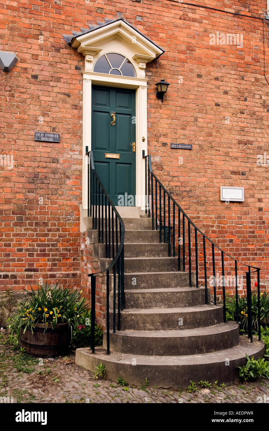 UK Wales Powys Montgomery Arthur Street tall steps to Old Stores House front door as flood prevention measure Stock Photo