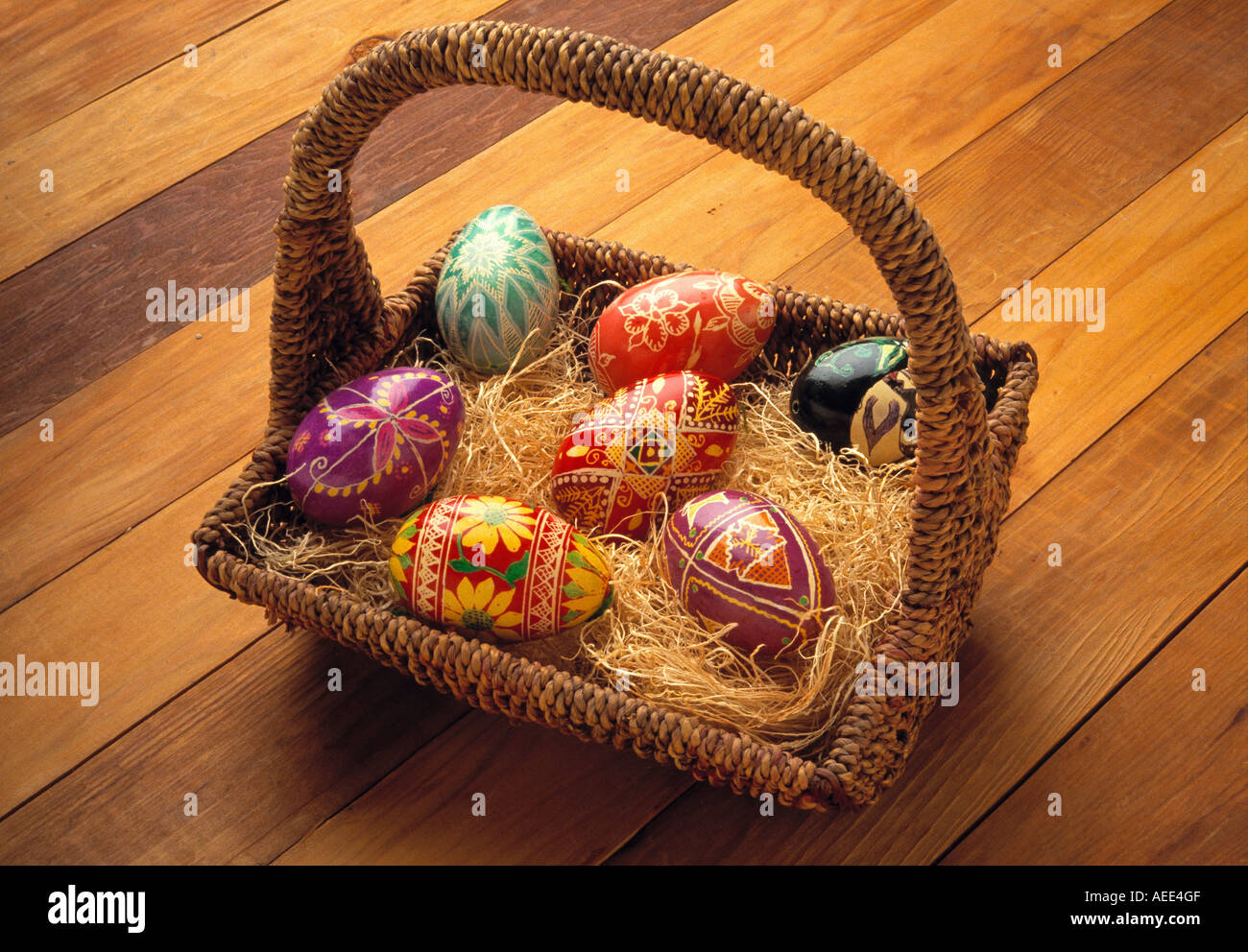 Ukrainian easter eggs in a rustic straw filled easter basket stock ukrainian easter eggs in a rustic straw filled easter basket negle Image collections