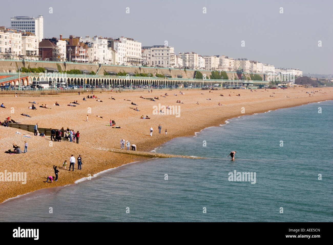 A busy and crowded Brighton beach and sea front on an unseasonably warm day in April Stock Photo