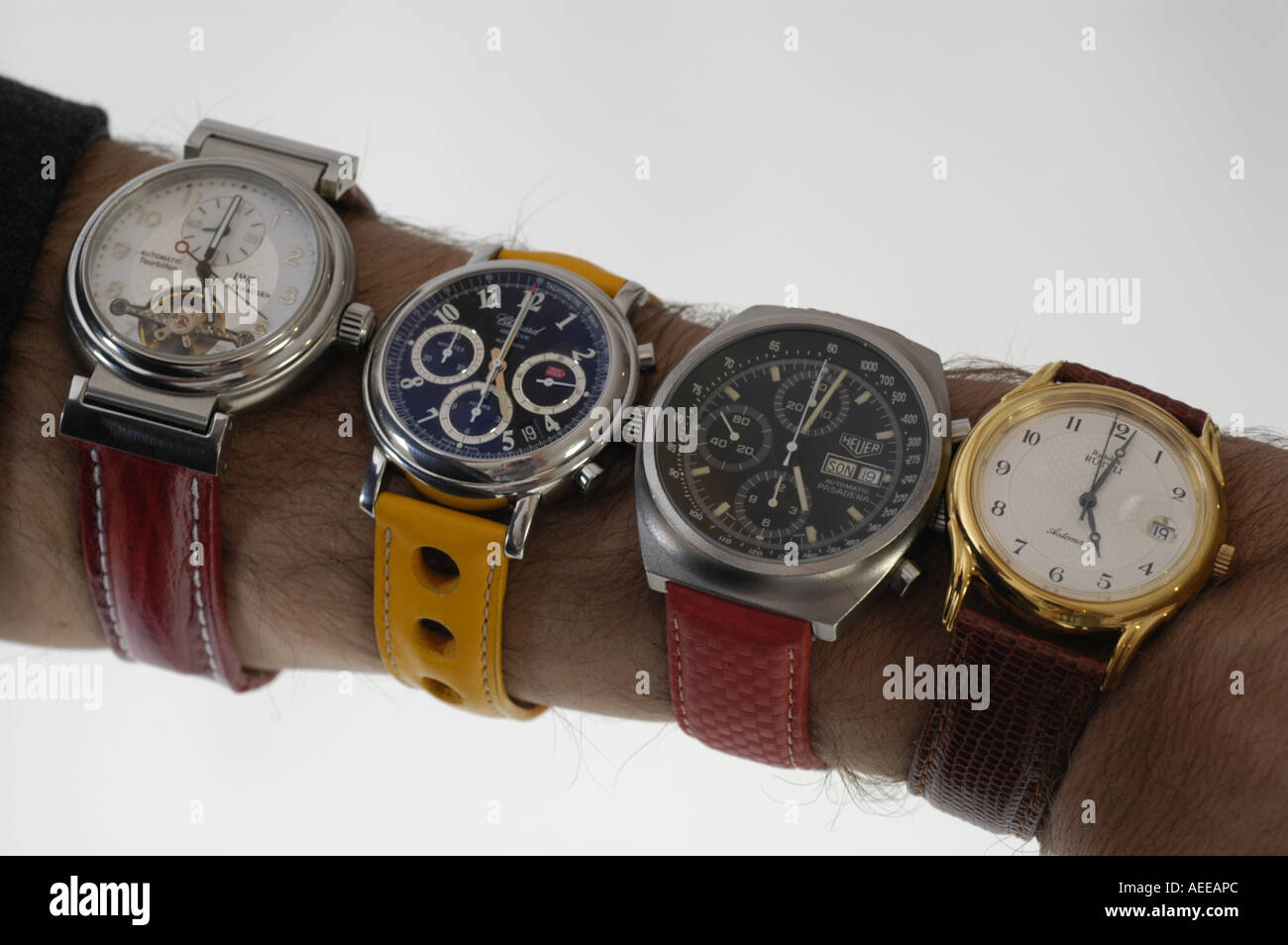 arm with five wristwatches deadline pressure - Stock Image