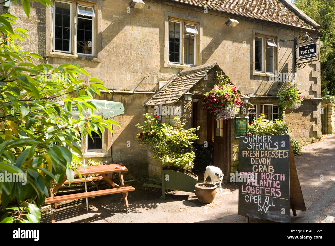 The Fox Inn in the Cotswold village of Great Barrington, Gloucestershire - Stock Image