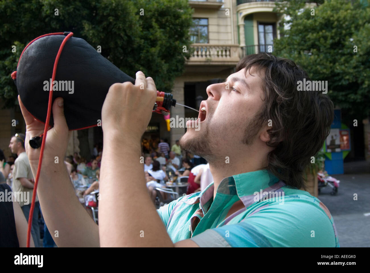 Sack 7805487 Photo Stock Young Leather From - San Wine Alamy Man Drinking A Traditional