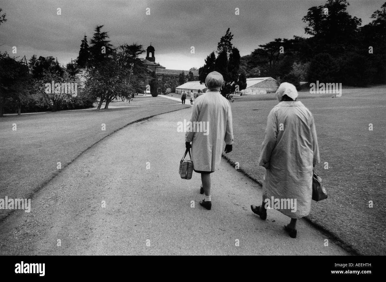 bb472af0c Two middle aged ladies in plastic raincoats walk in the ground of  Chatsworth House Derbyshire in 1973