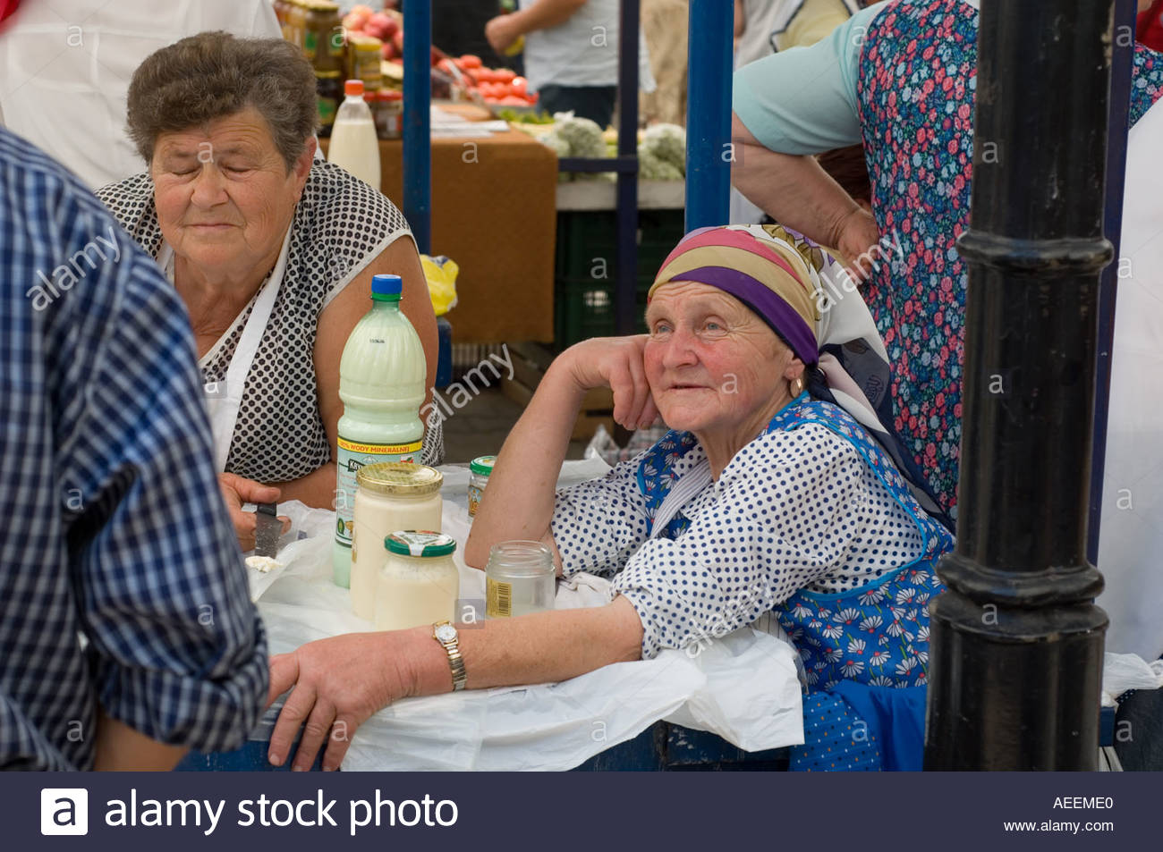 Peasant women sell cream cheese and other dairy produce at a market in Krakow - Stock Image