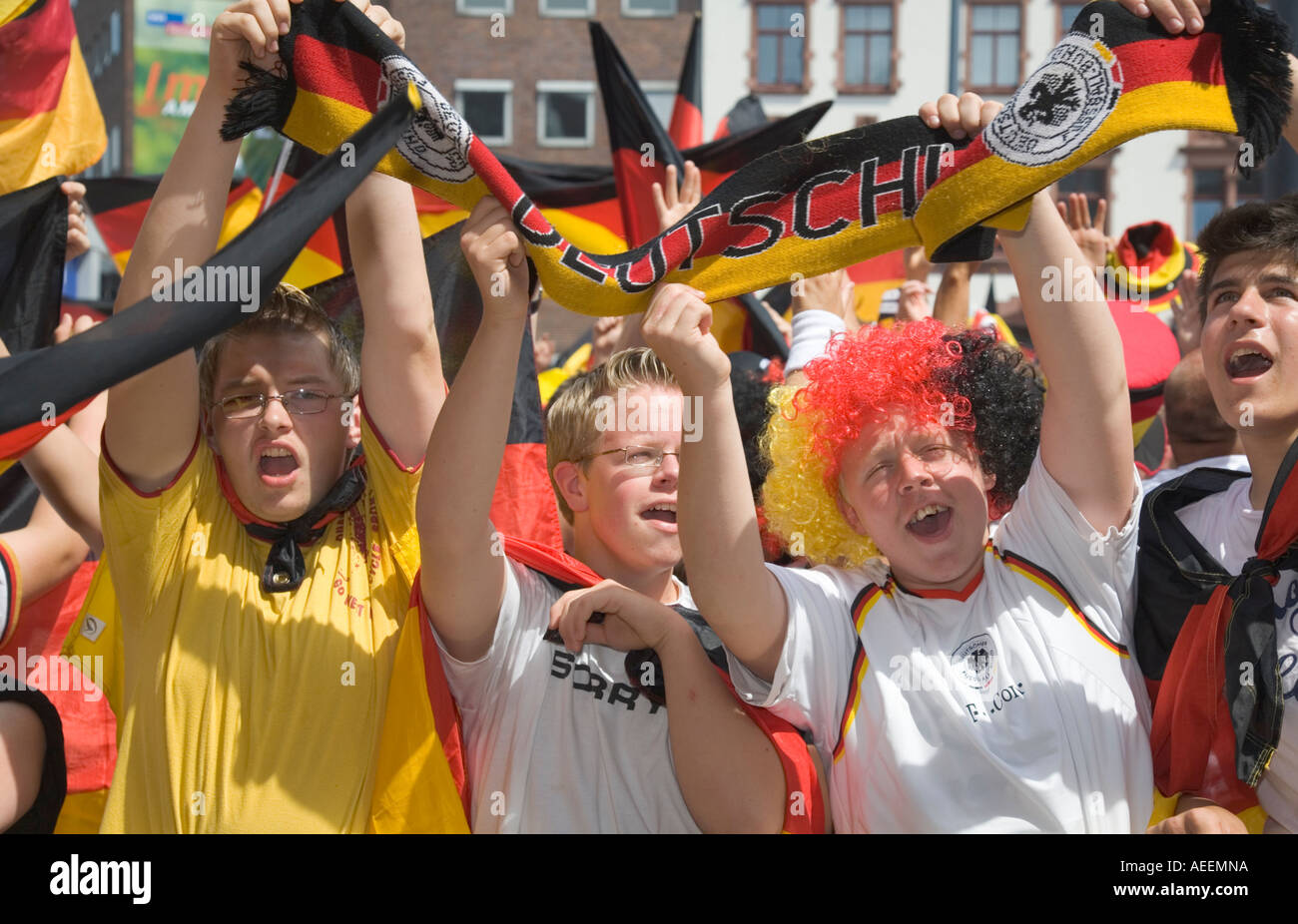 German Football Fans Cheering In Good Mood At A Football World Cup