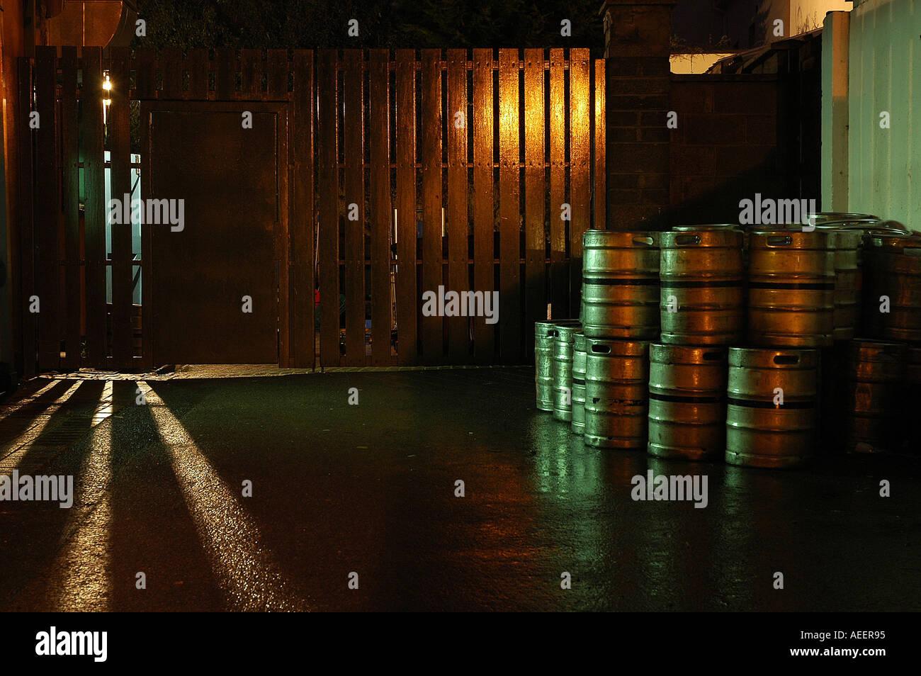 Beer barrels at night - Stock Image