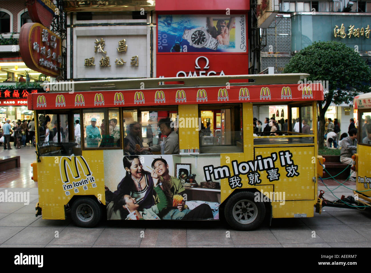Shanghai China - one of the mini trains taking pedestrians along the now pedestrianized Nanjing Road - Stock Image