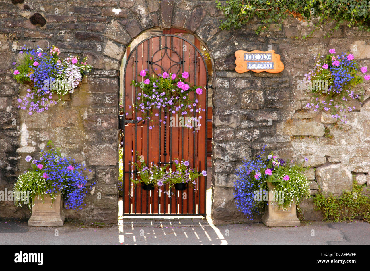 Floral display outside garden gate of house in Usk the town annually ...
