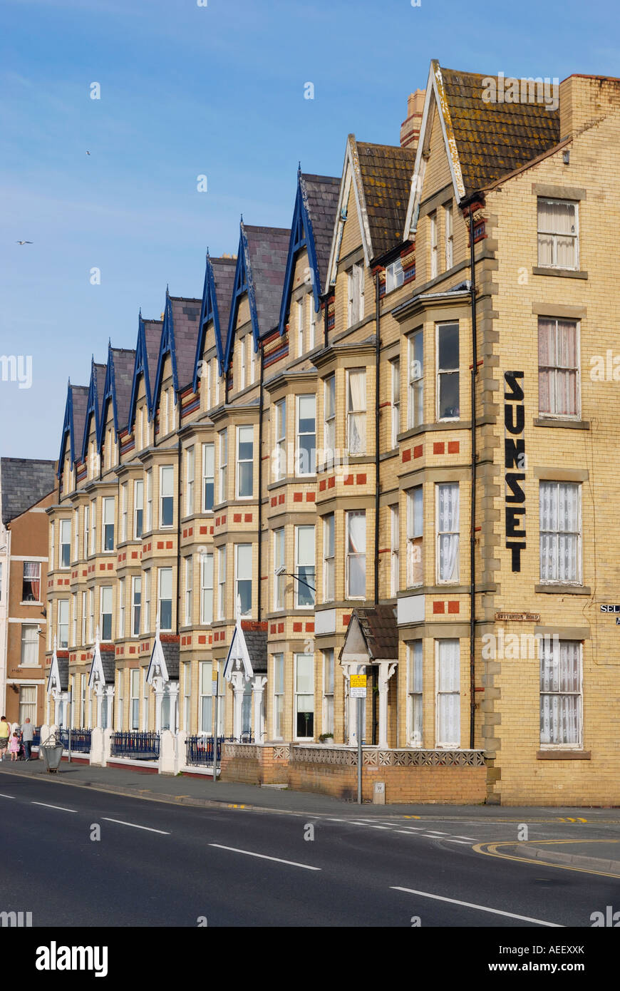 Refurbished seafront properties on the promenade in the coastal resort town of Rhyl, Denbighshire, North Wales - Stock Image