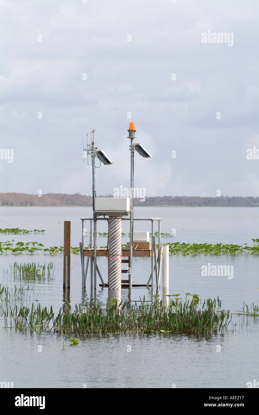 water quality monitoring station with solar panels Lake Istokpoga Florida stage monitor - Stock Image