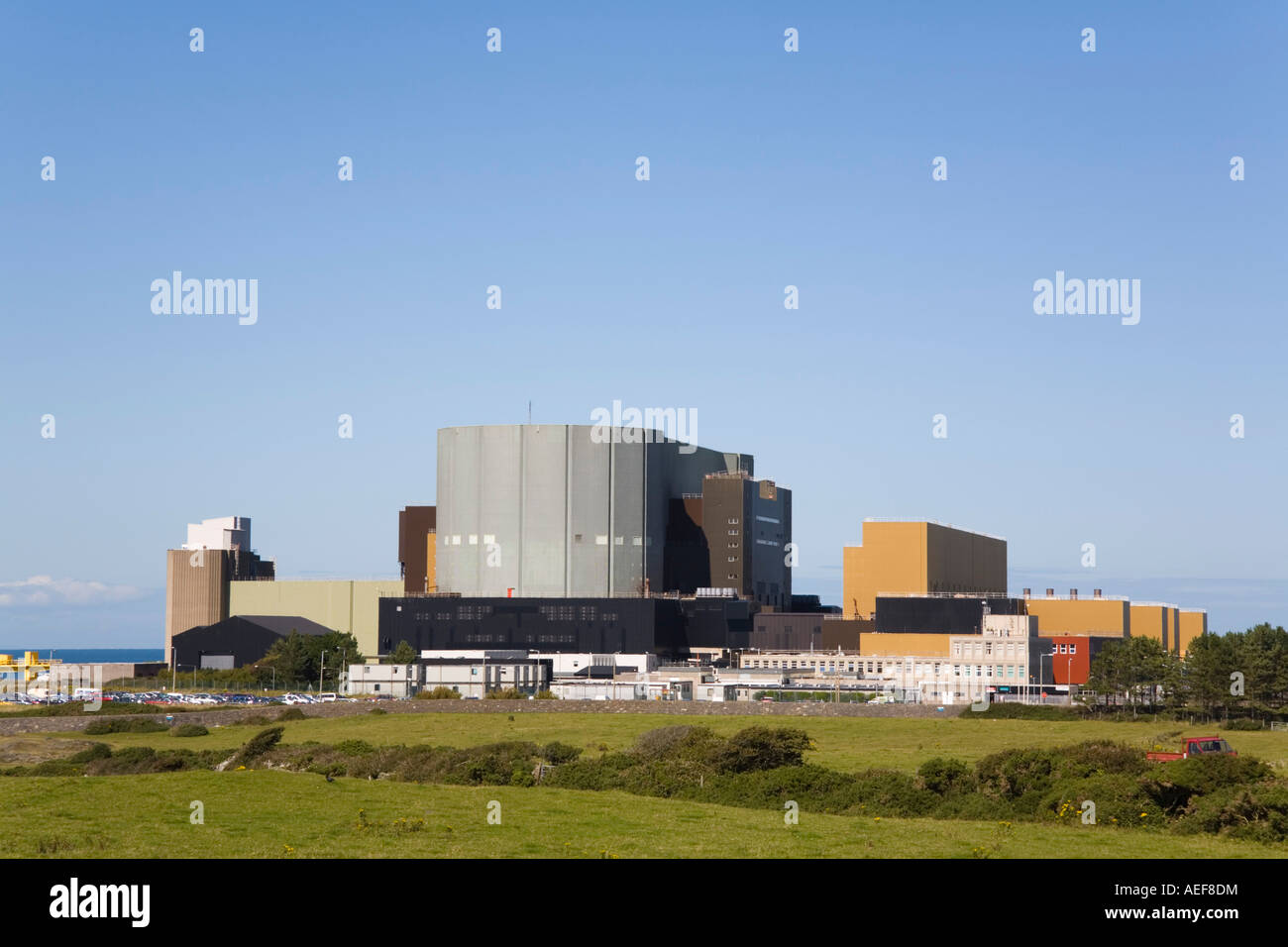 Wylfa A atomic energy Nuclear Power Station exterior on the Isle of Anglesey, Cemaes, North Wales, UK, Britain - Stock Image
