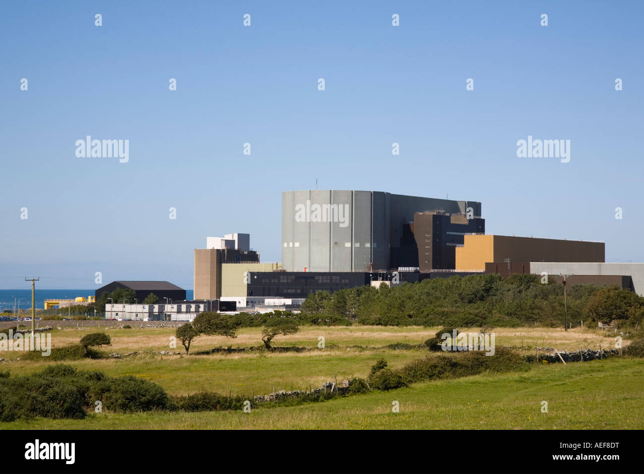 Wylfa Nuclear Power Station exterior atomic energy provider on north coast of Isle of Anglesey North Wales UK Britain. - Stock Image