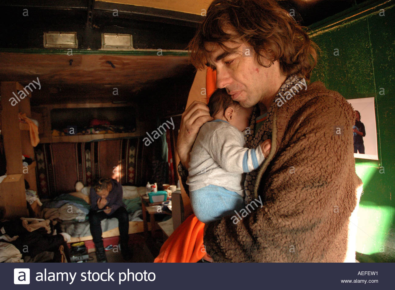 New Age traveller Father and new baby living in a horsebox  caravan. - Stock Image