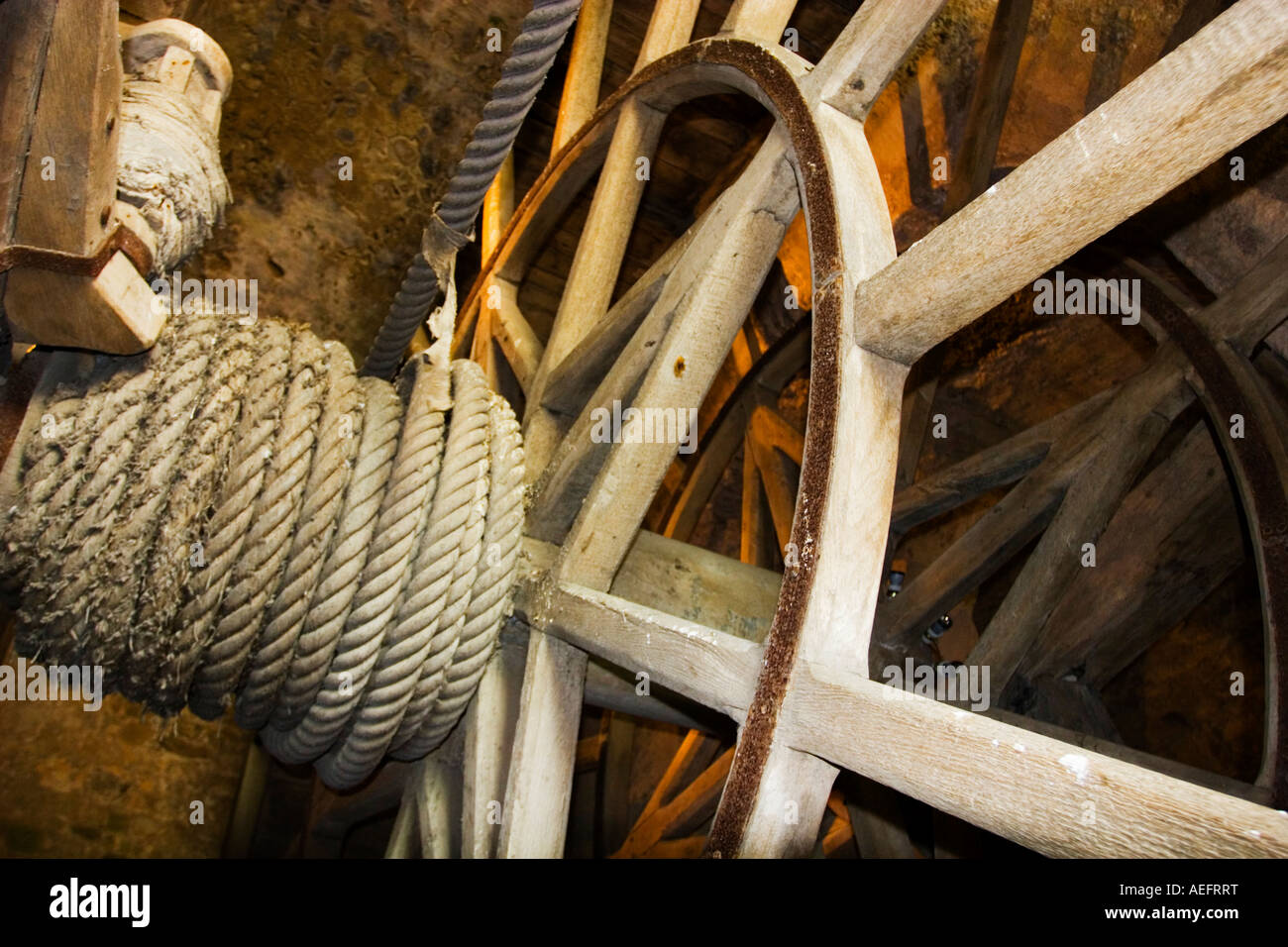 Winch mechanism for lifting supplies into the abbey of St Michel - Stock Image