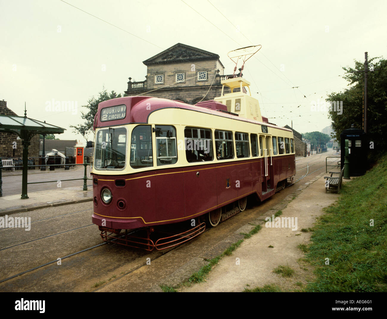 Derbyshire Crich Transport Tramways Museum tram with police call box and K1 phone box - Stock Image