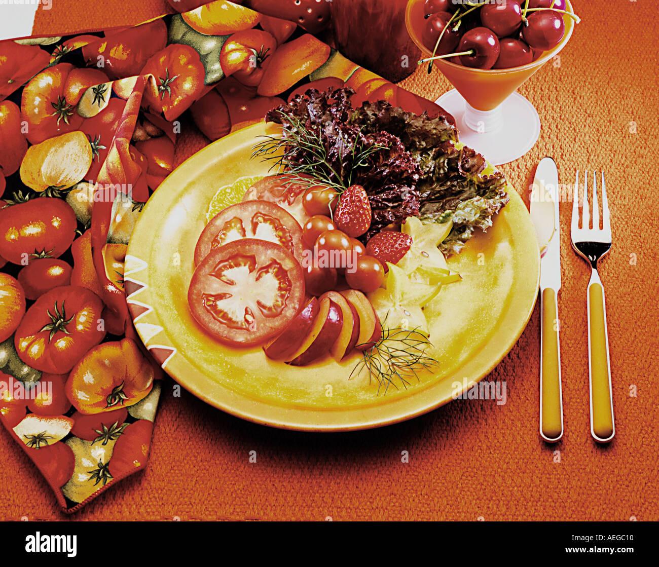 Food salad plate round dish silverware china fork knife setup table set napkin sliced tomato apple cup cherry cherries strawberr & Food salad plate round dish silverware china fork knife setup table ...