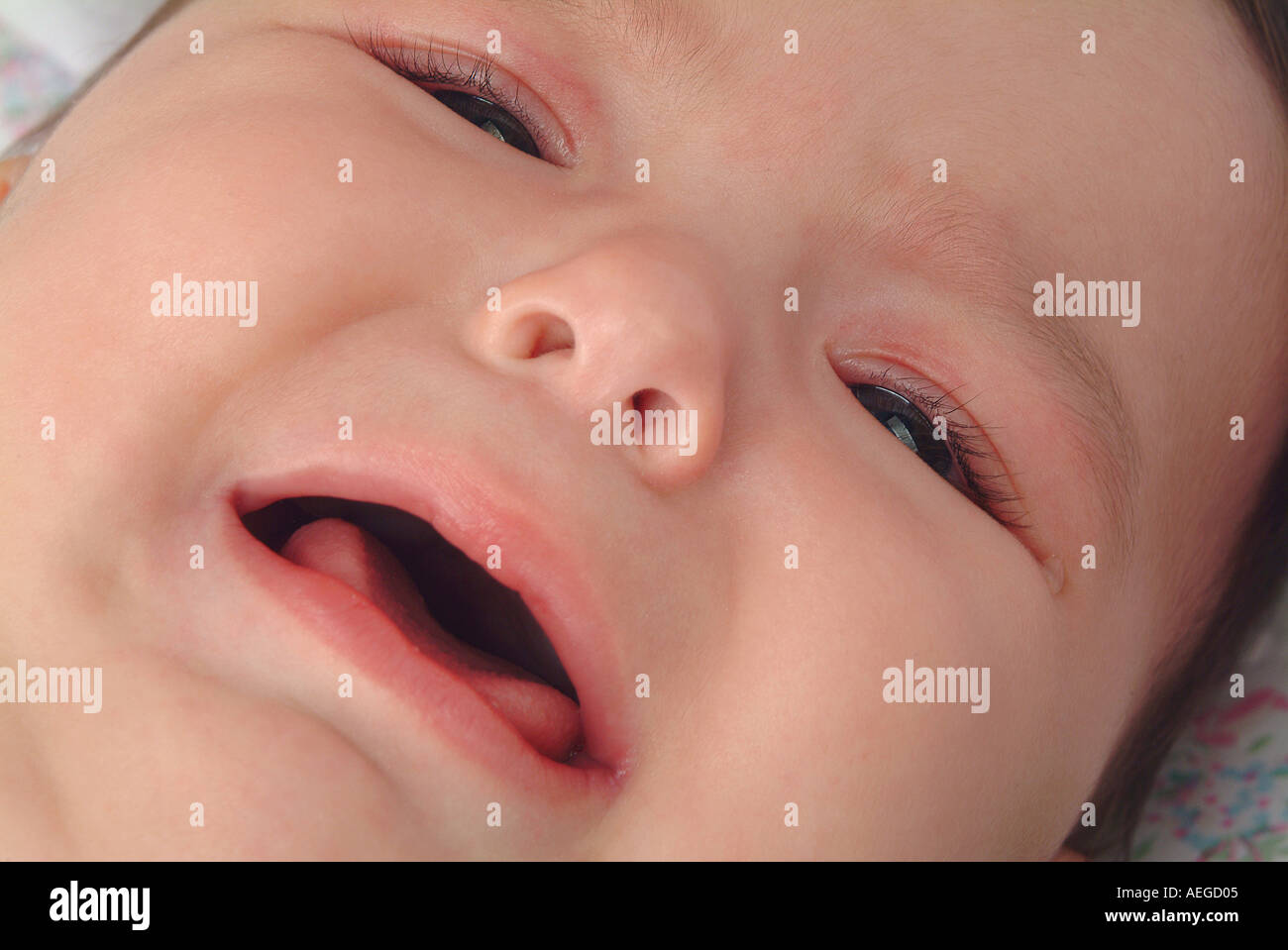 Baby baby crying sobbing lying white discomfort uneasy - Stock Image