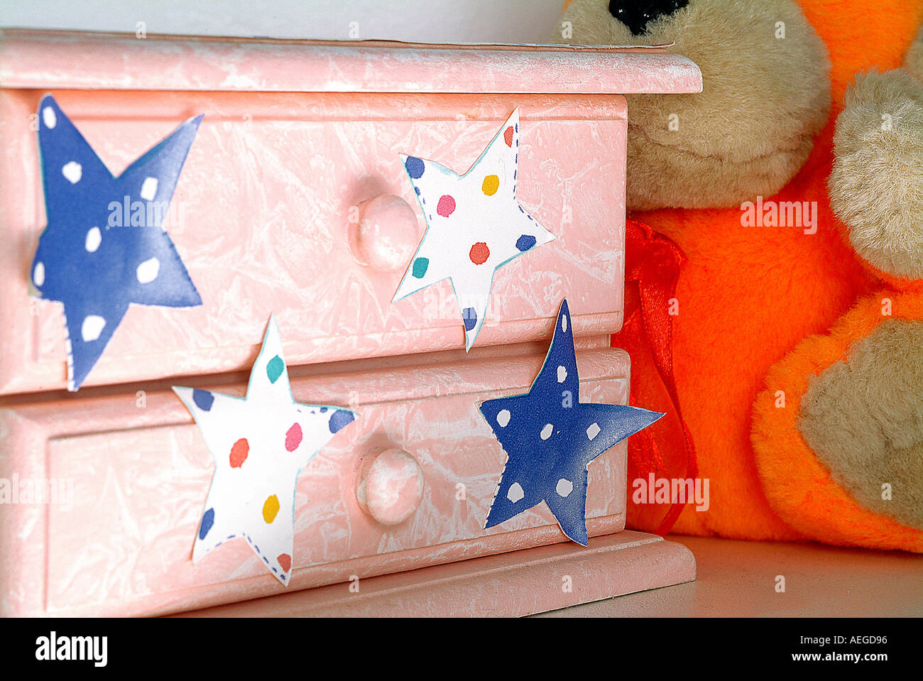 Baby s World drawers star decoration patina teddy bear child s bedroom detail nightstand miscellaneous leisure concept - Stock Image