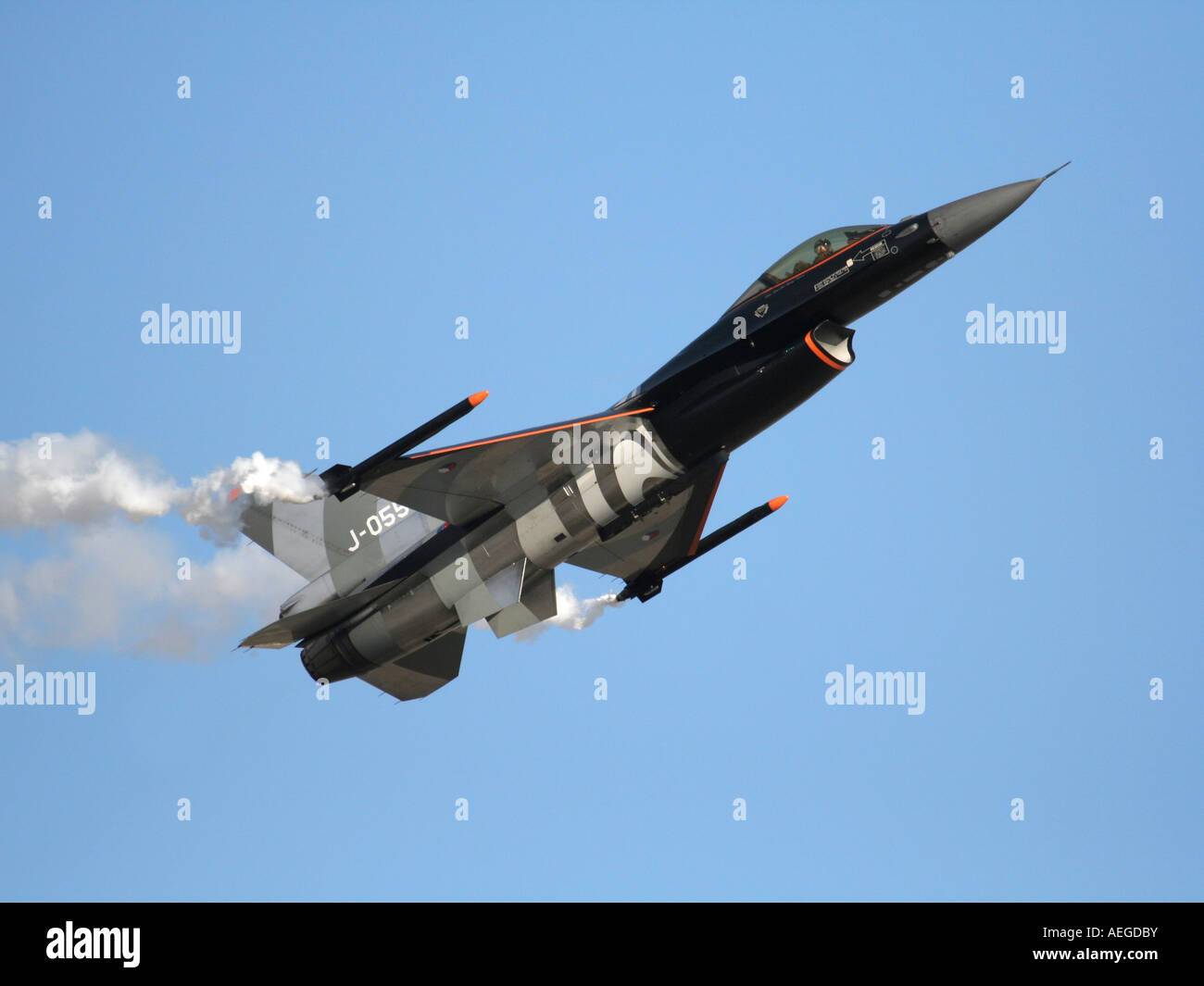 Royal Netherlands Air Force F-16 jet fighter flying nose up during an air display Stock Photo