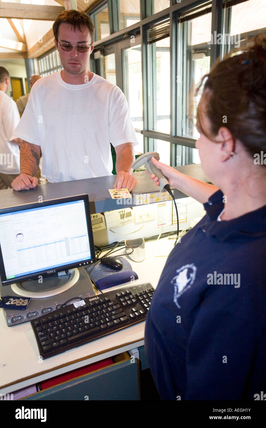 Inmate ID card being scanned as inmate is leaving facility to go to work. Omaha, Nebraska, USA. - Stock Image