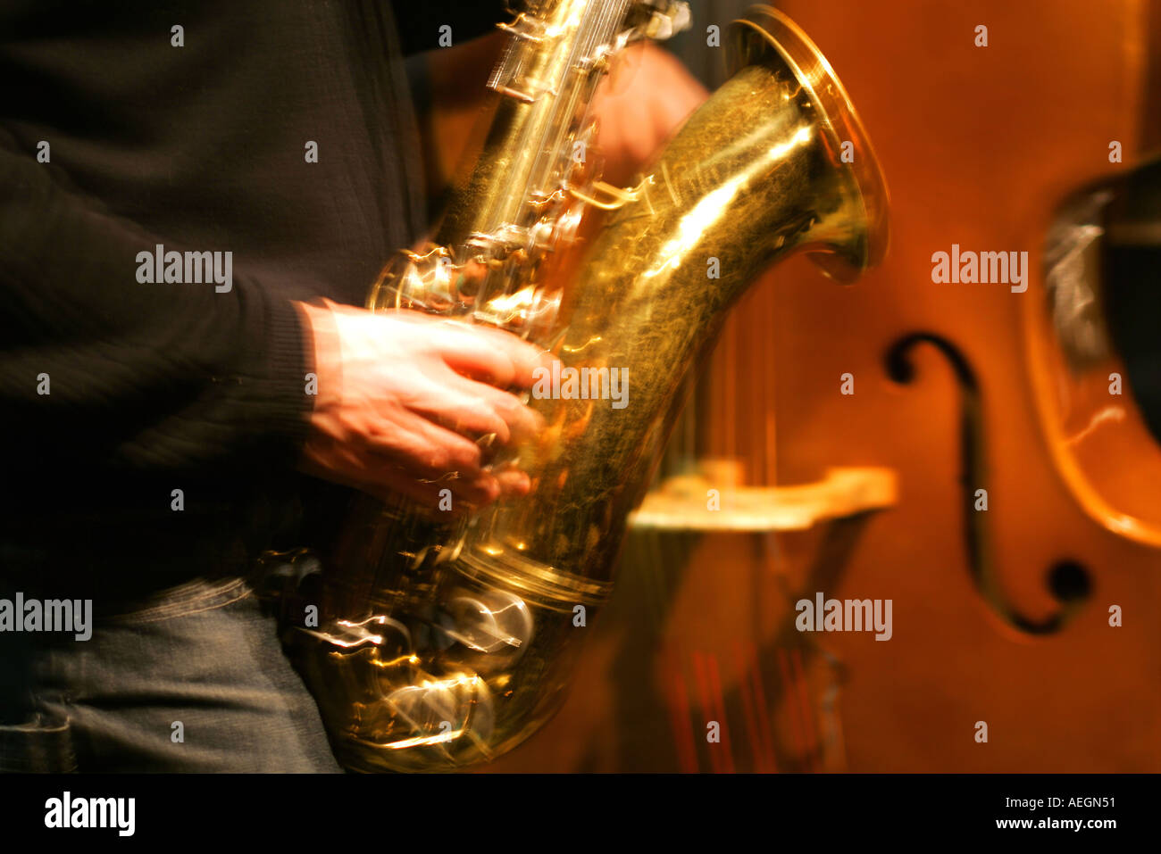 Blur of saxophone and upright bass  Stock Photo