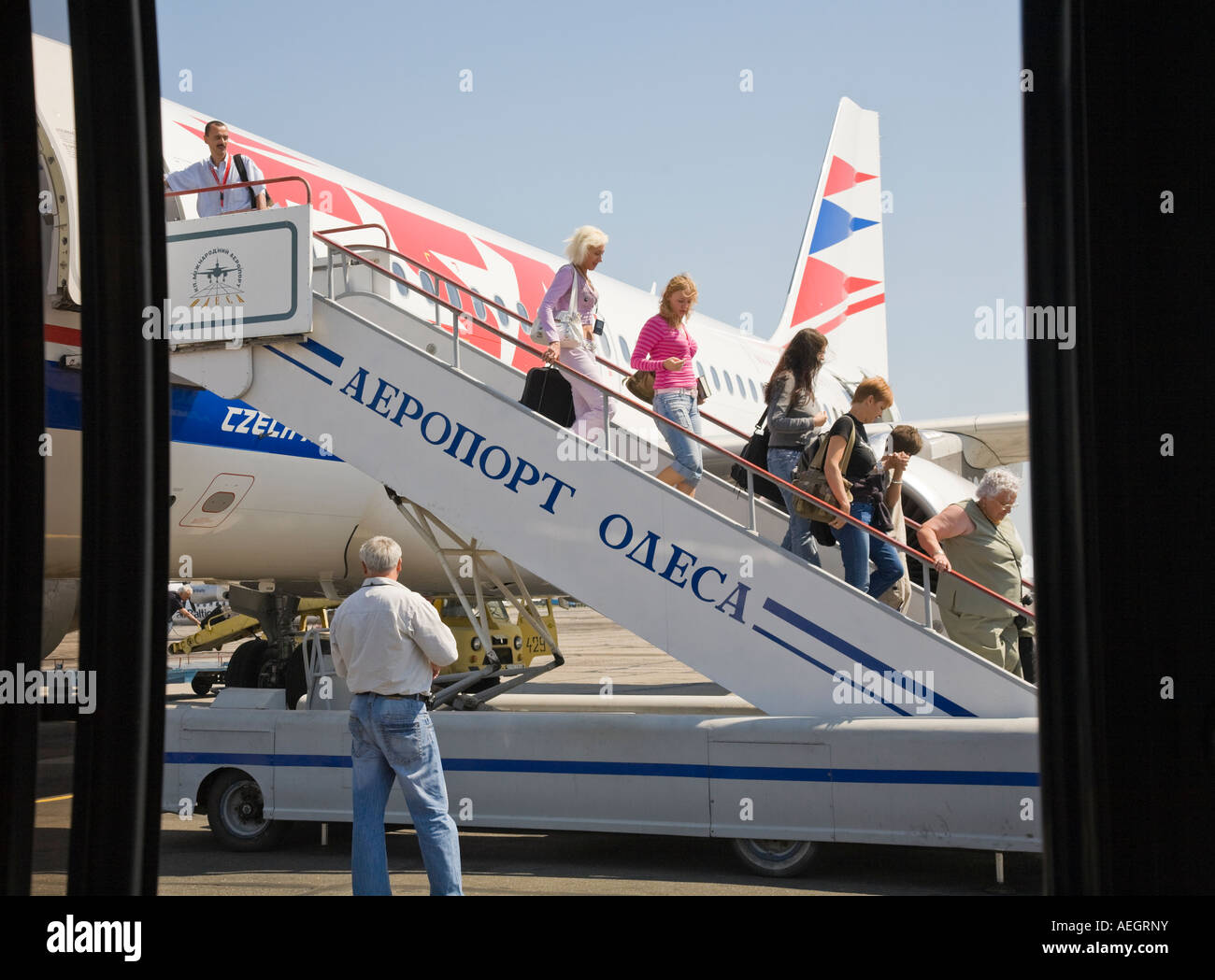 Passengers leaving the plane on the Odesa International Airport in Ukraine - Stock Image