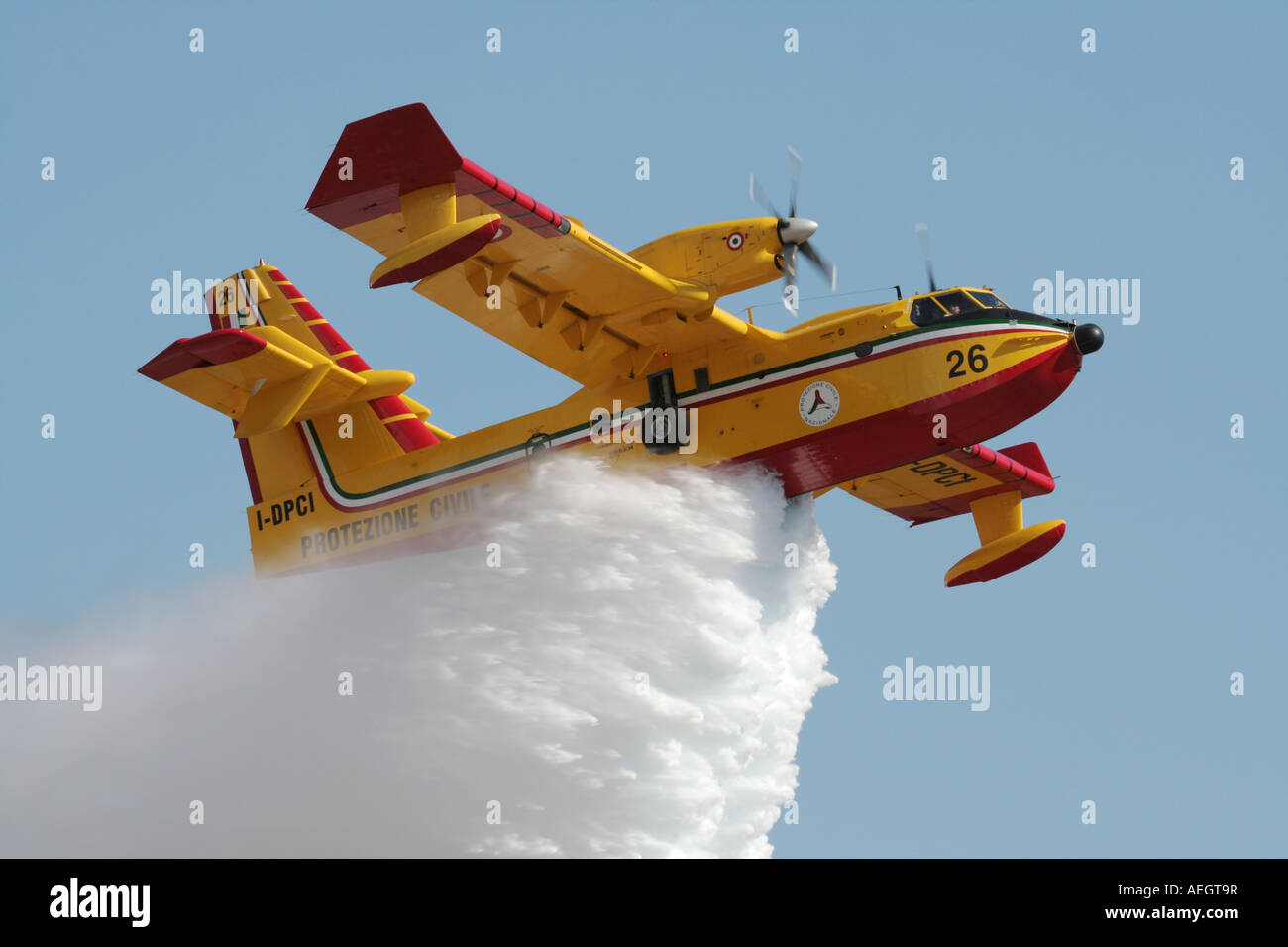 Bombardier 415 (Canadair CL-415) water bomber demonstrating its fire-fighting abilities as it releases its load - Stock Image