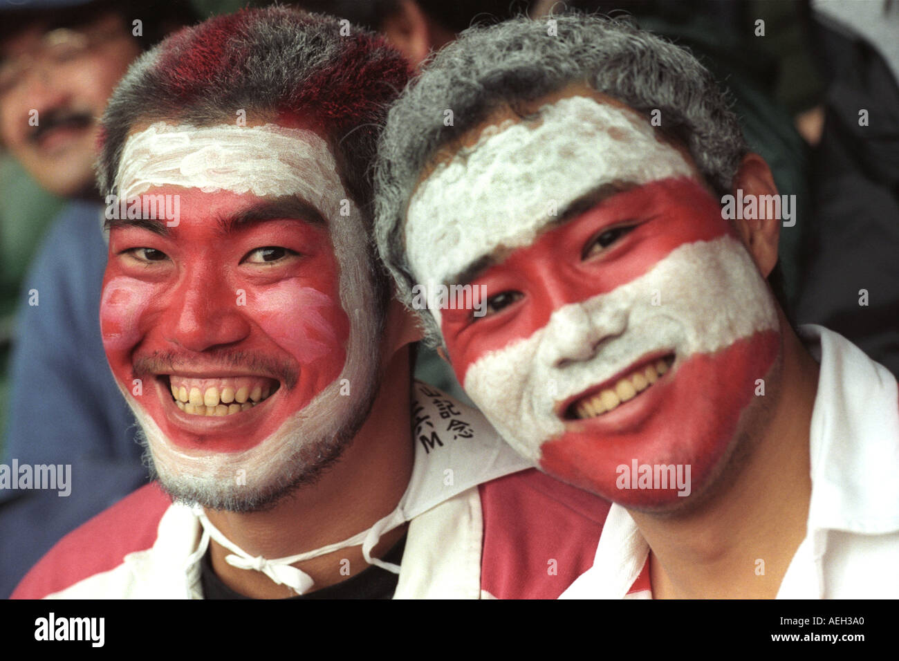 Japanese rugby fans with painted faces supporting their team at  an international match in Millennium Stadium Cardiff Wales UK - Stock Image