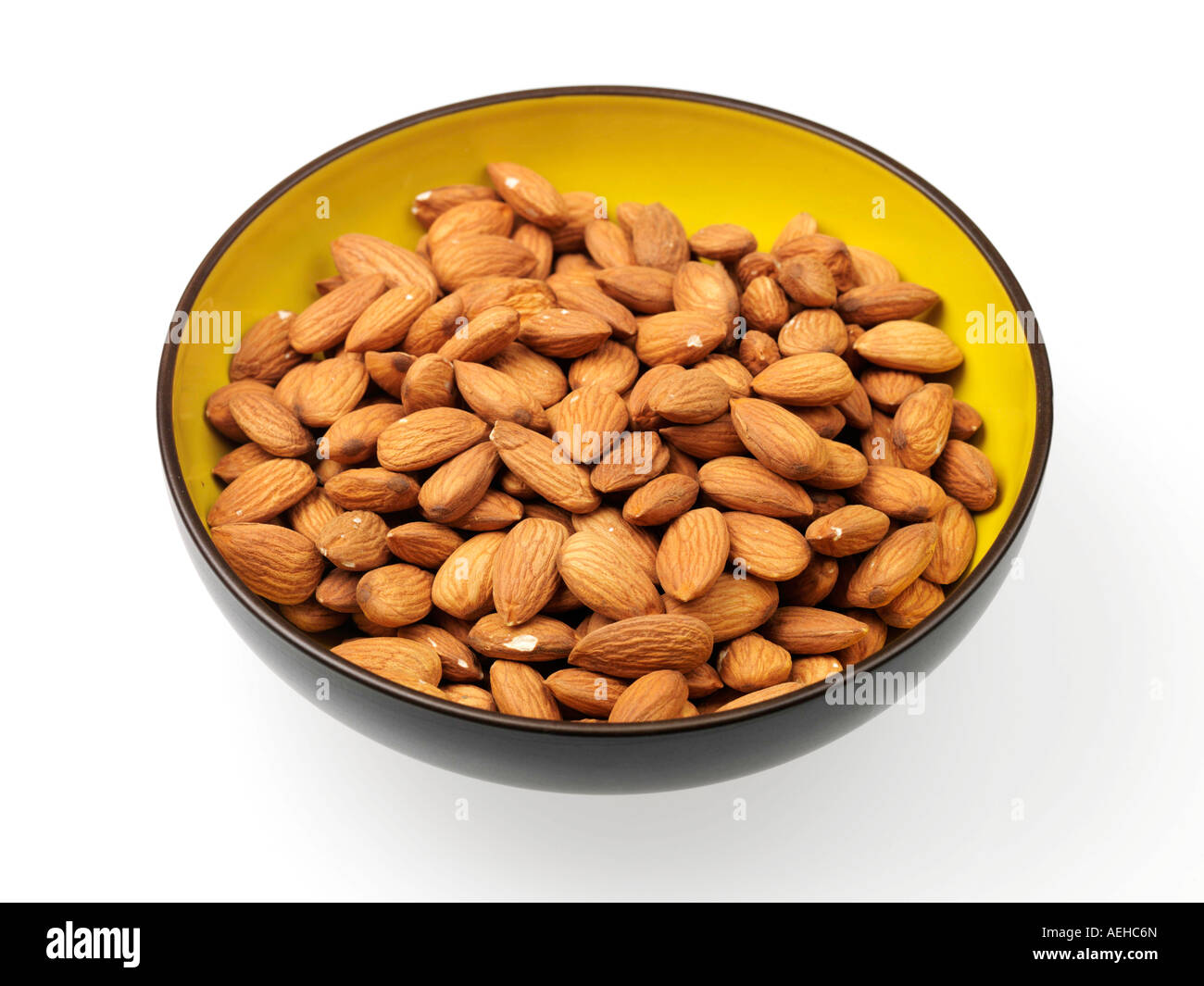 Bowl Full Of Healthy Vegetarian Almonds Against A White Background With A Clipping Path And No People Stock Photo