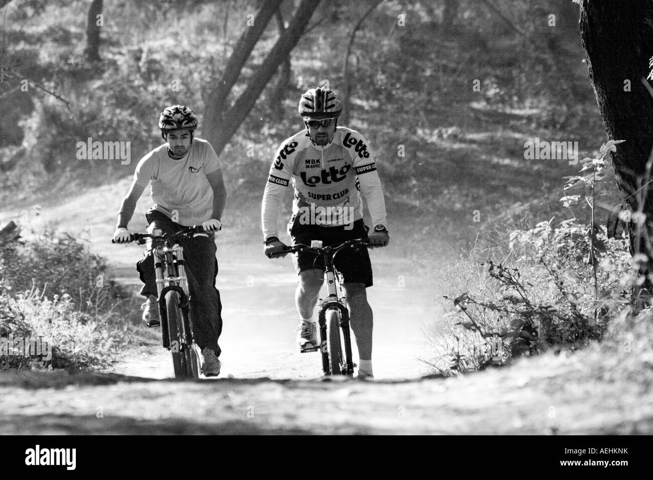 Mountain bikers racing on the rough track in the wild during MTB championship at Chandigarh, India - Stock Image