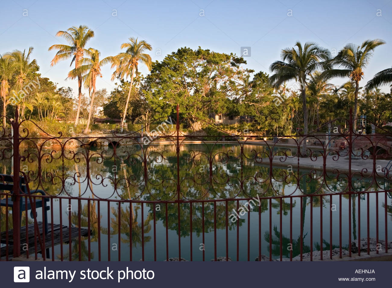 Decorative wrought iron fence surrounds Venetian Pool in Coral Gables Miami - Stock Image