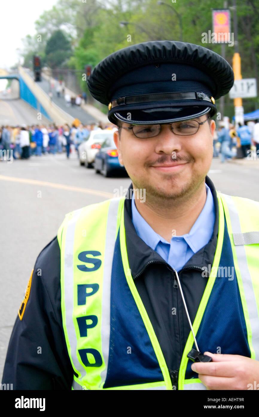 Happy Latino police crossing guard age 20. Cinco de Mayo Fiesta ...