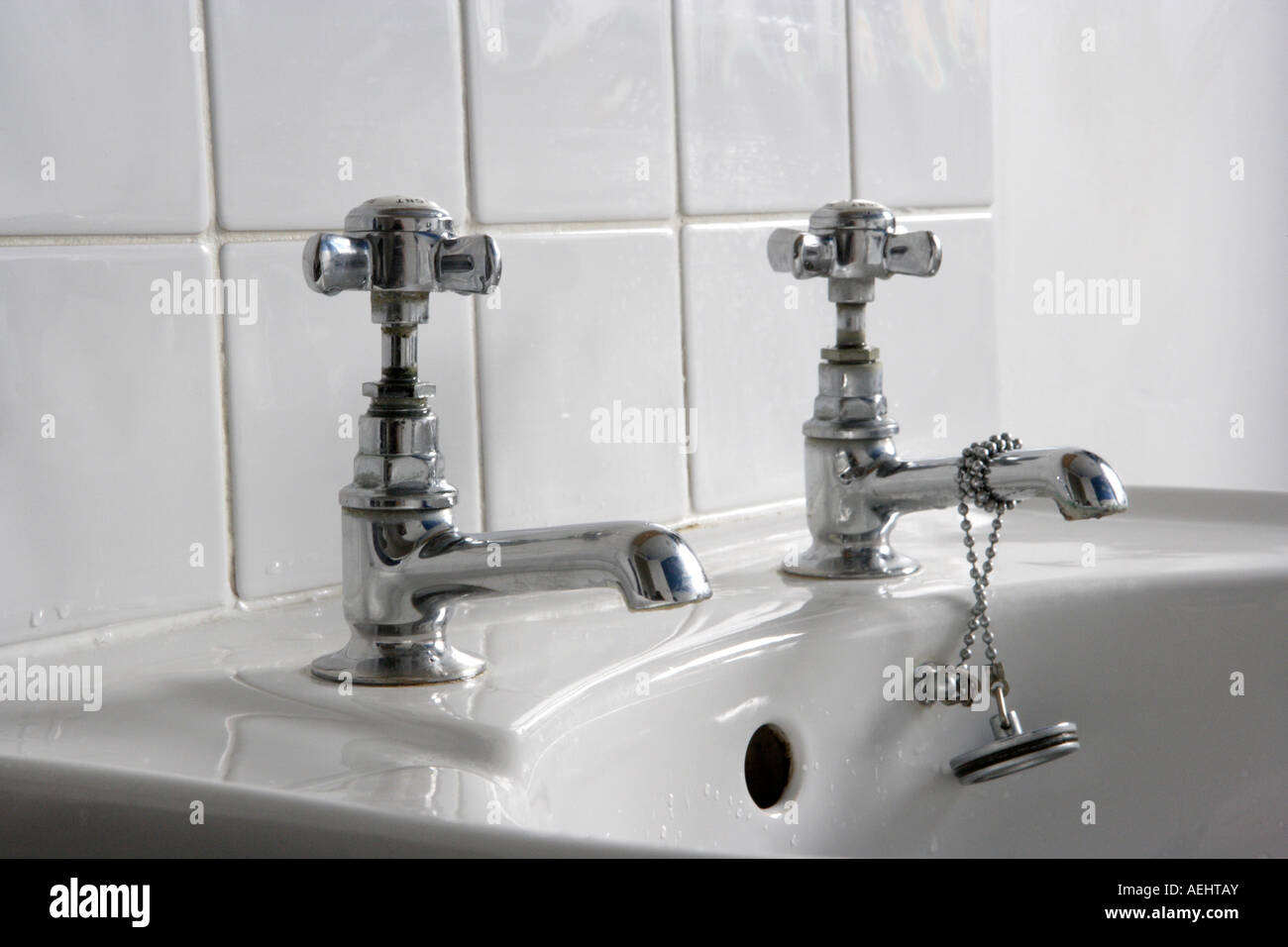 White bathroom sink with silver taps and plug Stock Photo: 13690562 ...