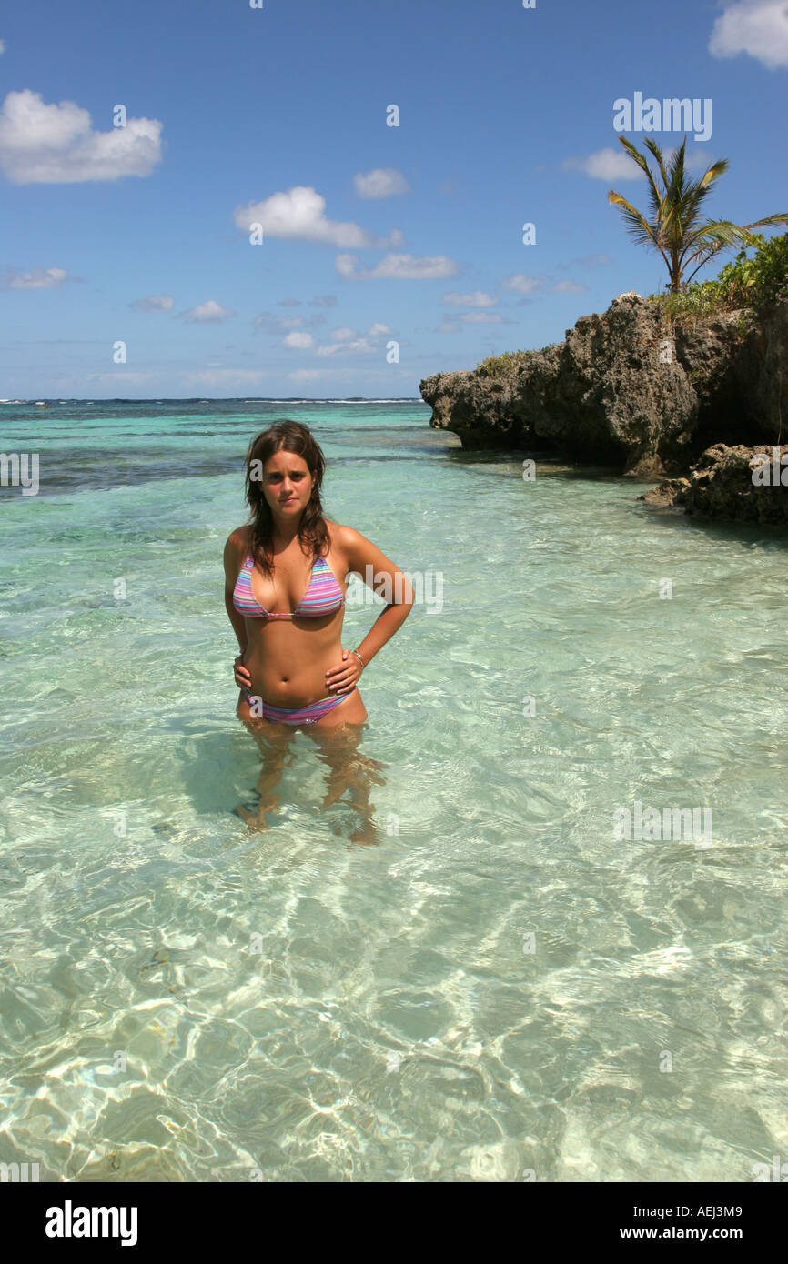 09a6eb5a7672 Young woman in the tropical crystal sea of Playa Madama Las Galeras Samana  Dominican Republic