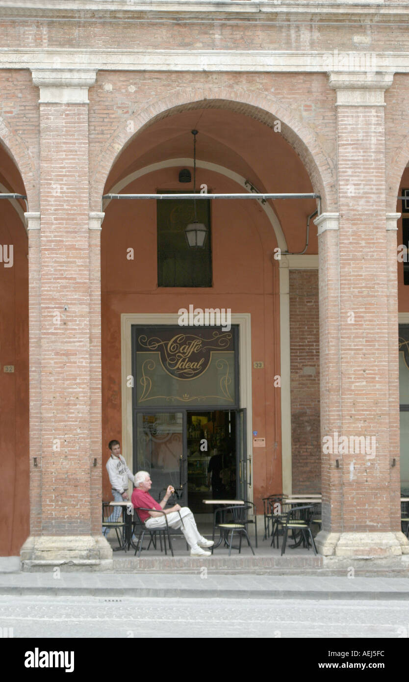 Visitor enjoys a cup of coffee outside a local cafe in Fabriano , Le Marche , Italy Stock Photo