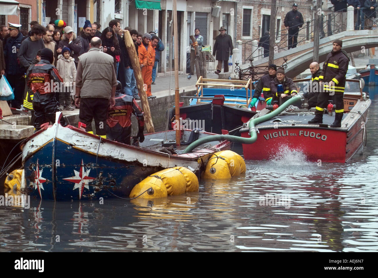 Raising a boat sunk in a Venetian canal - Stock Image