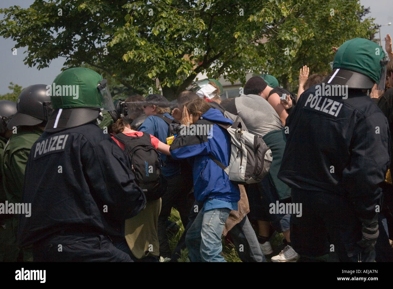 Policemen using pepper spray on protesters against the G-8 summit, Mecklenburg-Western Pomerania, Germany - Stock Image