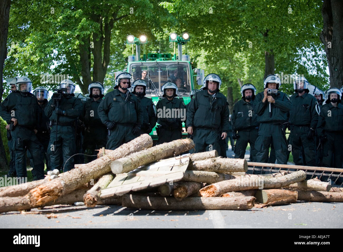 Police officers behind a barricade, access road to the G-8 summit, Mecklenburg-Western Pomerania, Germany Stock Photo
