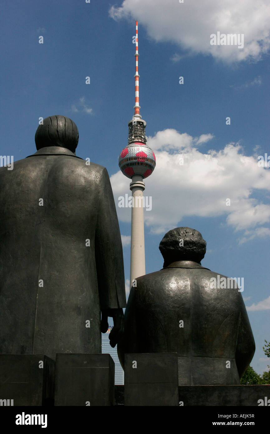 Communists Marx and Engels in front of the TV tower in the german capital Berlin Germany - Stock Image