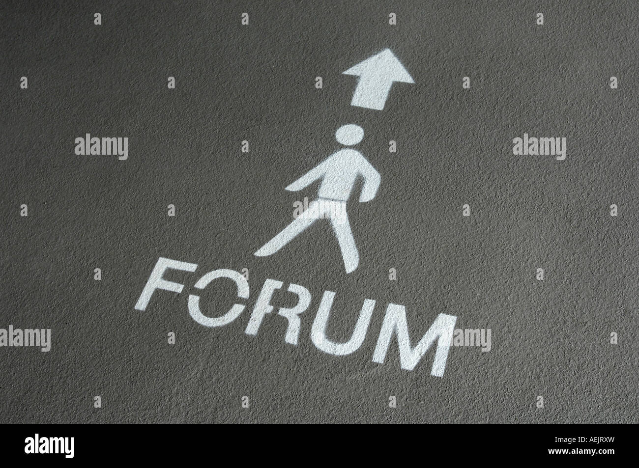 """Icon: """"Forum"""" painted on the floor. Stock Photo"""