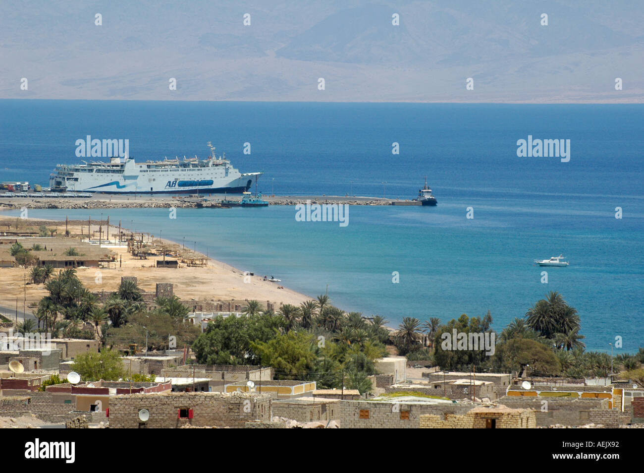 Ferry boat from Aqaba operated by AB (Arab Bridge) Maritime anchored in the bay of Nuweiba or Nueiba a coastal town in Sinai Peninsula, Egypt - Stock Image
