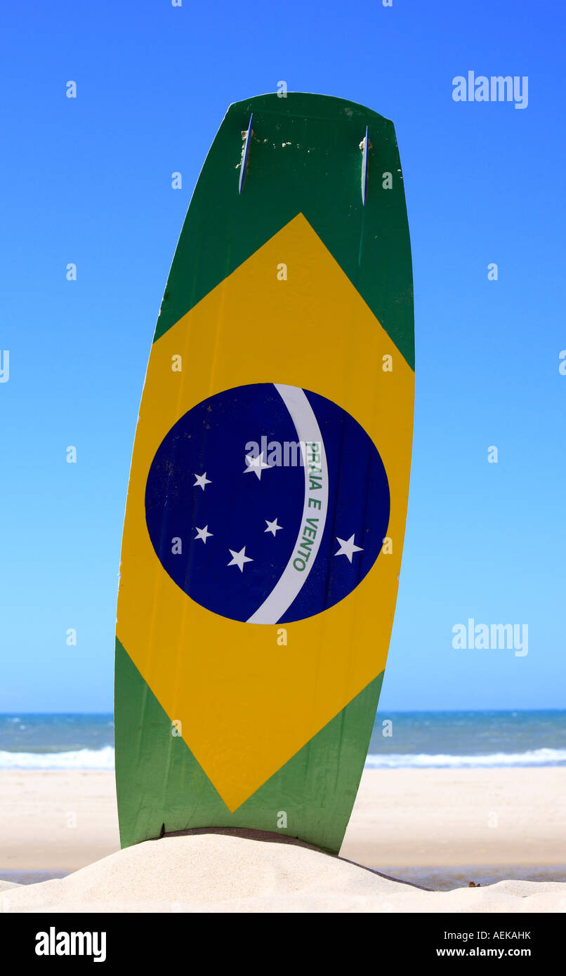 brazilian flag painted on a kite surf board with 'praia e vento' (beach and wind) instead of 'ordem - Stock Image