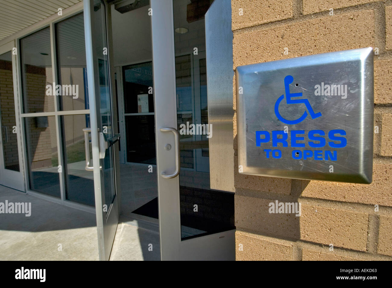 Attractive Senior Male Uses Handicap Accessible Door To Enter A Building   Stock Image