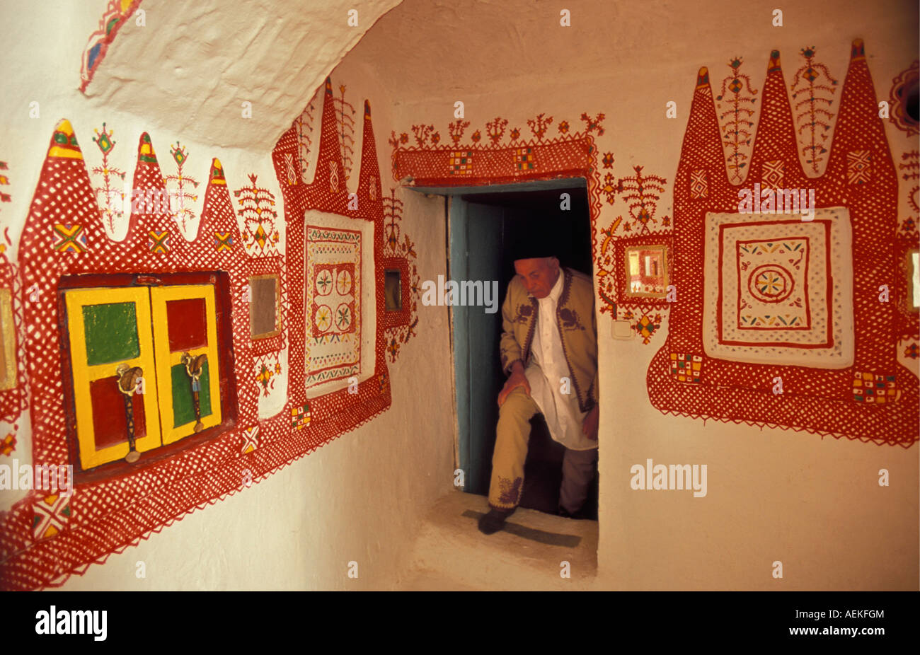 Libya Ghadames Local Berber man standing in house with painted walls - Stock Image