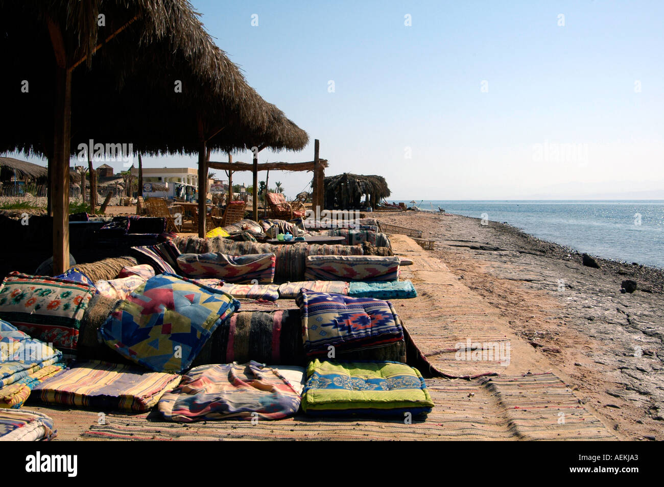 Sun loungers in Nuweiba Tarabin beach in Nuweiba also spelled: Nueiba a coastal town in the eastern part of Sinai Peninsula, Egypt - Stock Image
