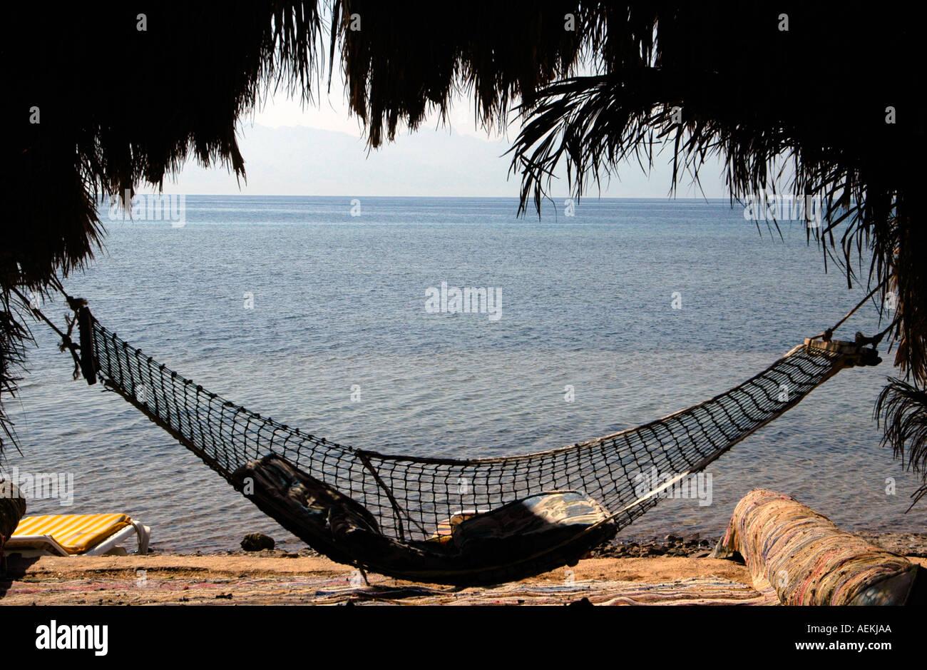 A hammock in Nuweiba Tarabin beach in Nuweiba also spelled: Nueiba a coastal town in the eastern part of Sinai Peninsula, Egypt - Stock Image