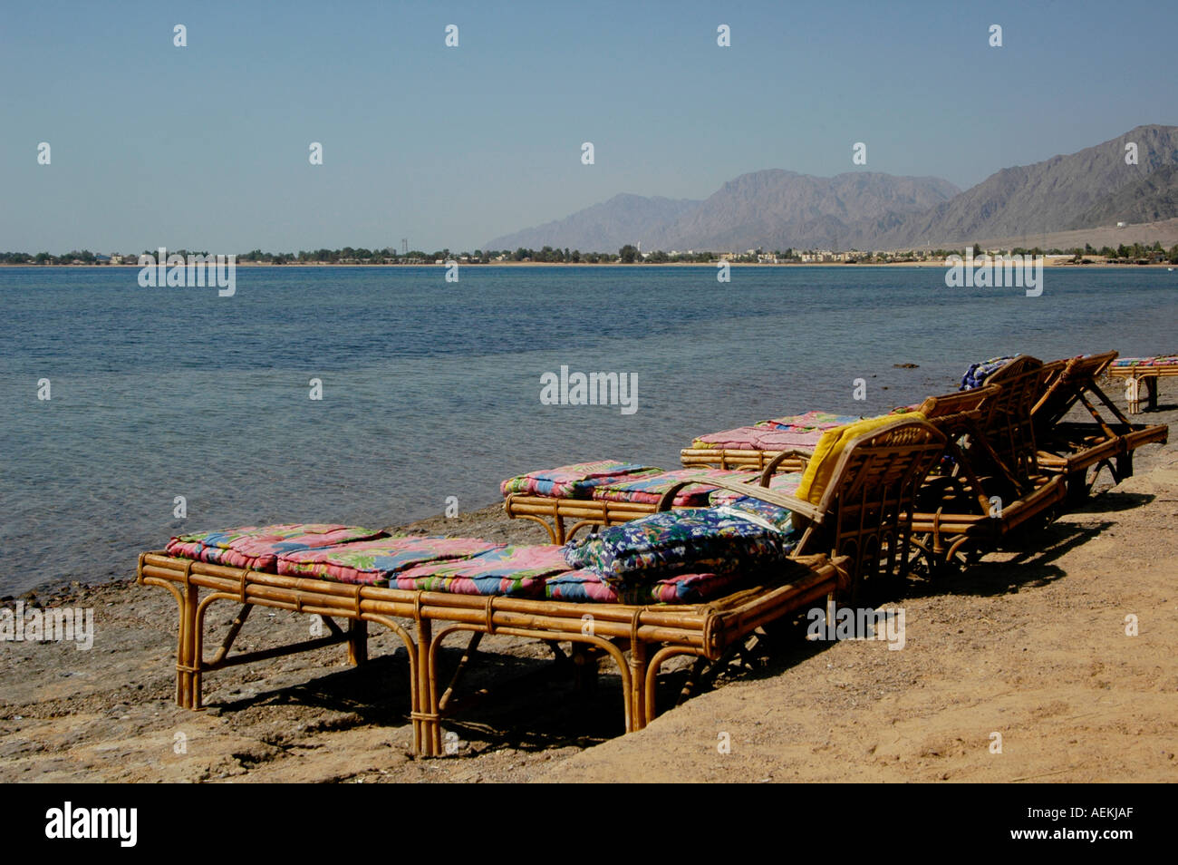 Empty sun loungers in Nuweiba Tarabin beach in Nuweiba also spelled: Nueiba a coastal town in the eastern part of Sinai Peninsula, Egypt - Stock Image