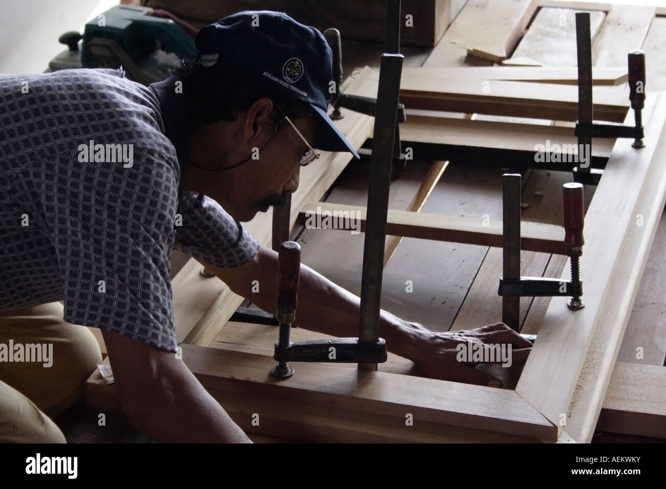 A carpenter making a wooden frame Stock Photo: 13709822 - Alamy